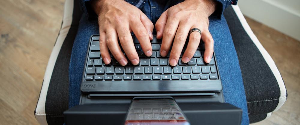 Man typing on a Flex Universal Keyboard