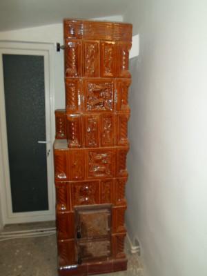 Soba de teracota cu serpentina foto