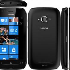 Vand Nokia 710 lumia cu husa flip + accesorii . Necodat in nici o retea de telefonie . - Telefon mobil Nokia Lumia 710 Toshiba, Negru, Neblocat