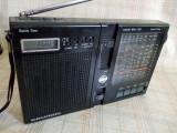 Radio portabil cu ceas si alarma Grundig Yacht Boy 120 cu 4 benzi