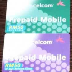 MALAYSIA. 2 CARTELE TELEFON CELCOM PREPAID MOBILE - Cartela telefonica straina