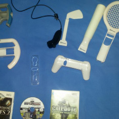 Nintendo Wii + 1 controler + 3 jocuri (Medal Of Honor Heroes 2, Call Of Duty Modern Warfare, Super Truck) si inca cateva accesorii care apar in poze.