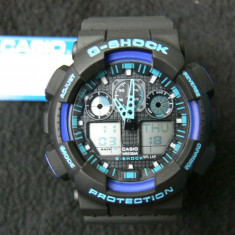 CASIO G-SHOCK GA-100-1A4ER BLACK&BLUE DESIGN-MADE IN JAPAN-MANUAL-POZE REALE - Ceas barbatesc Casio, Sport, Quartz, Cauciuc, Alarma, Analog & digital
