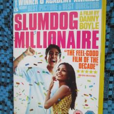 SLUMDOG MILLIONAIRE (VAGABONDUL MILIONAR) - film DVD (original din ANGLIA, in stare impecabila!!!) - Film romantice, Engleza