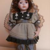 Frumoasa papusa cu cap, maini si picioare din portelan, inaltimea piesei 30 cm, stare foarte buna, ideala pentru colectie !