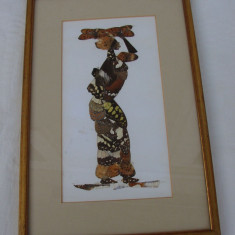 Adevarata arta realizata din aripi de fluturi, reprezentand o negresa, arta africana