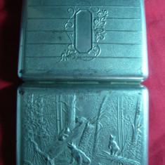 Tabachera metal nichelat cu ursuleti ,cu fotografii din filme in interior