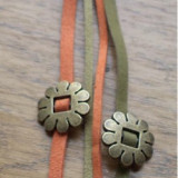 Bratara unisex, piele intoarsa olive si dovleac cu module bronz care gliseaza
