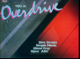 -Y- HITS IN OVERDRIVE - DIRE STRAITS / SIMPLE MINDS / GLENN FREY  / DISC VINIL