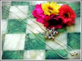 AuX: LANTISOR ptr. fete realizat din metal, sistem de reglaj ingenios cu medalion in forma de frunza cu pietricele multicolore si clopotei-inimioara!, Femei