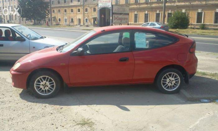 Mazda 323 foto mare
