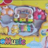 Carusel mecanic cu muzica si animalii - Carusel patut