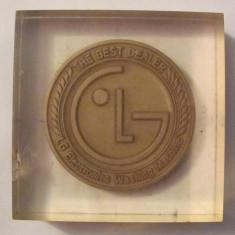 "MMM - Medalie LG ""Cel mai bun dealer de masini de spalat 2004"""