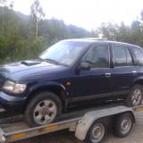 Dezmembrez kia sportage benzina