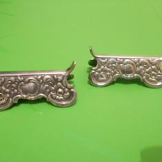 Doua vechi SUPORTURI ARGINTATE pentru TACAMURI, decorate in relief, marcate, Ornamentale