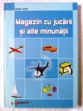 """""""MAGAZIN CU JUCARII SI ALTE MINUNATII"""", St. Voda, 2002. Constructii lemn, carton"""