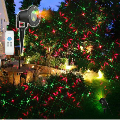 Laser craciun exterior instalatie jocuri de lumini rosu si verde foto