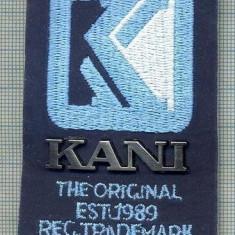 255 -EMBLEMA - KANI - THE ORIGINAL EST 1989 REG. TRADEMARK -starea care se vede
