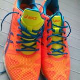 ASICS Men's Gel-Solution Speed 2 Tennis Shoe,Flash Orange/Blue/Flash Yellow