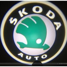 Proiector laser cu logo/marca pentru iluminat sub usa SKODA