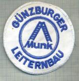 73 - EMBLEMA MANECA-GUNZBURGER LEITERNBAU -MUNK -GERMANIA -starea care se vede