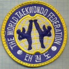 154 -EMBLEMA - SPORTIVA -THE WORLD TAEKWONDO FEDERATION -starea care se vede