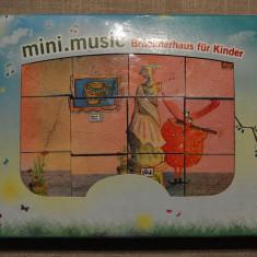 Joc cu 12 cuburi, formeaza 6 imagini legate de muzica, foarte artistice, 16x22cm - Jocuri arta si creatie