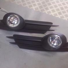 proiectoare opel corsa D tot cu suportu de plastic