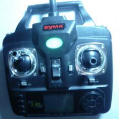 Telecomanda SYMA pt. Elicopter ,nava,auto ,cu baterii .Actioneaza pe dist=30m