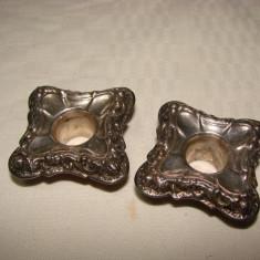 Doua suporturi de lumanari pentru sfesnice, placate cu argint