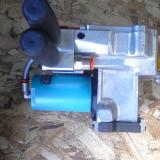 Dispozitiv de legat cu banda de plastic