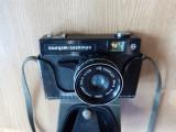Cumpara ieftin APARAT FOTO VINTAGE CU FILM ,RUSESC ,CU HUSA ORIGINALA   -FUNCTIONAL