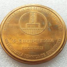 MEDALIA SOCIETATII ROMANE DE GEOTEHNICA SI FUNDATII-CONFERINTA 2004