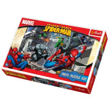 Puzzle Spiderman urmarit de dusmanii sai 100 pcs Trefl