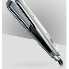 Placa pentru indreptat parul Frizz Therapy Remington S9951 - Placa de par