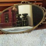Oglindă cu ramă metalică
