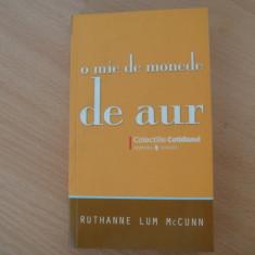 RUTHANNE LUM McCUNN  --  O MIE DE MONEDE DE AUR