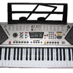 Orga Electronica cu 61 de Clape, Microfon, 100 Ritmuri Tonuri si Suport Partitura MQ-001 UF
