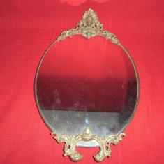 Oglinda cu rama din alama si bronz 40x25 cm
