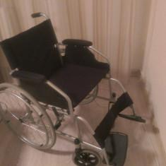 Vand scaun cu rotile aproape nou