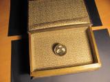 Brosa din aur de 12k cu intarsie in pietre semipretioase si carte falsa