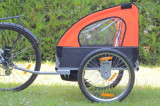 Remorca de bicicleta cu suspensie marca Samax, portocalie