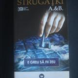 STRUGATKI A B - E GREU SA FII ZEU