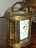 Un deosebit ceas de colectie de voiage din bronz cu un deosebit