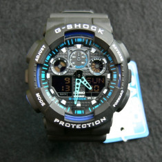 CASIO G-SHOCK GA-100-1A4ER, BLACK&BLUE-BLACK FACE-POZE REALE-MANUAL-MODEL 2017 - Ceas barbatesc Casio, Sport, Quartz, Cauciuc, Alarma, Analog & digital