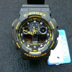 CASIO G-SHOCK GA-100-1A4ER, BLACK&YELLOW-BLACK FACE-POZE REALE-MANUAL-MODEL2017 - Ceas barbatesc Casio, Sport, Quartz, Cauciuc, Alarma, Analog & digital