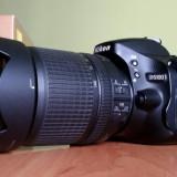 Nikon D5100 cu  obiectiv Nikkor 18-140mm f / 3.5-5.6