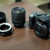 Camera foto mirrorless Panasonic Lumix G1 + 2 obiective si accesorii
