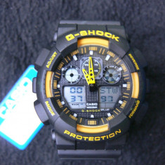 CASIO G-SHOCK GA-100-1A4ER BLACK&YELLOW DESIGN-MADE IN JAPAN-MANUAL-POZE REALE - Ceas barbatesc Casio, Sport, Quartz, Cauciuc, Alarma, Analog & digital