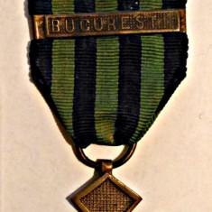 MEDALIA CRUCEA COMEMORATIVA A RAZBOIULUI AN 1919 CU BARETE CARPATI SI BUCURESTI - Ordin